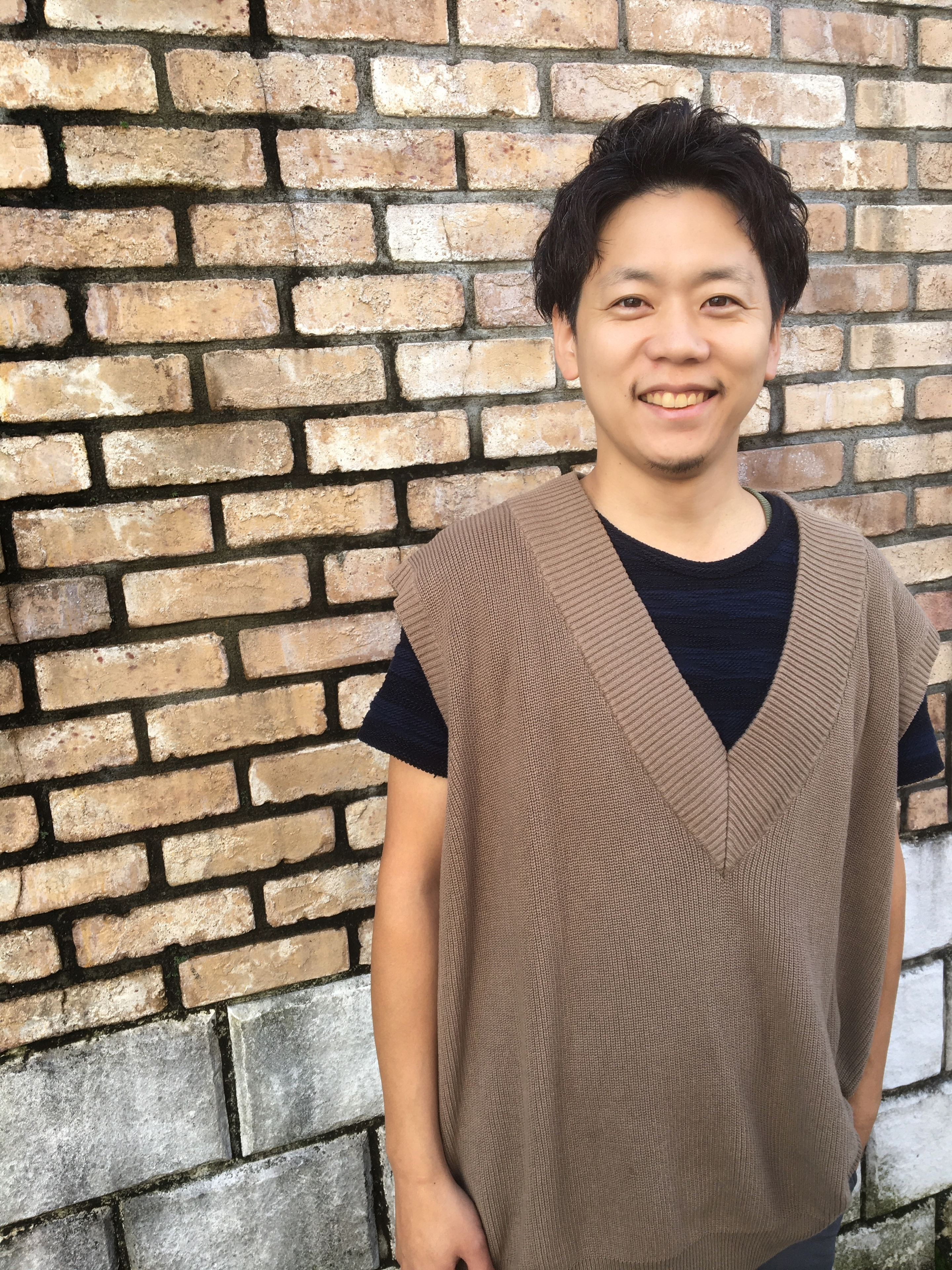 Stylist岡崎武